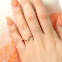 V shaped diamond ring in rose gold curved wedding band by la more design