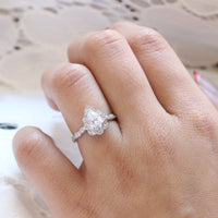Vintage floral pear moissanite engagement ring white gold diamond scalloped band by la more design jewelry