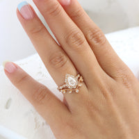Vintage floral pear moissanite ring bridal set and curved leaf diamond wedding band rose gold by la more design jewelry