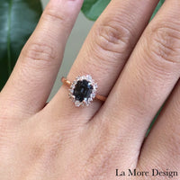 Elegant yet unique grey spinel diamond engagement ring is crafted in a 14k rose gold tiara halo diamond ring setting featuring a 1.38-carat cushion cut natural grey spinel center encircled by a halo of brilliant white diamonds to create the truly one of a kind look ~ the total gemstone and diamond weight of the whole ring is 1.68 ct.tw.