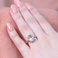 aquamarine engagement ring rose gold oval halo diamond band by la more design