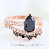 black and white diamond pear solitaire ring wedding set in rose gold crown diamond band bridal set by la more design jewelry