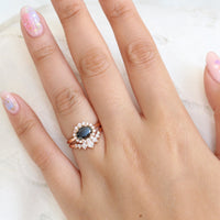 Oval black diamond ring and 7 stone diamond wedding band in rose gold halo bridal set by la more design jewelry