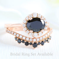 Oval black diamond ring and curved crown diamond wedding band in rose gold halo bridal set by la more design jewelry