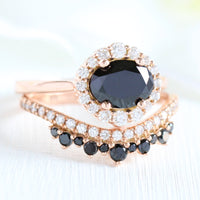 black diamond ring and curved crown diamond wedding band in rose gold halo diamond bridal set by la more design jewelry