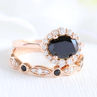 black diamond ring and matching diamond wedding band in rose gold halo diamond bridal set by la more design jewelry