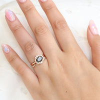Oval black diamond ring and scalloped diamond wedding band in rose gold halo bridal set by la more design jewelry
