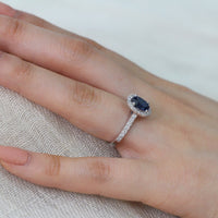 blue sapphire halo diamond engagement ring white gold oval cut ring by la more design