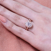 rose gold halo bridal set pear moissanite ring and scalloped diamond band by la more design