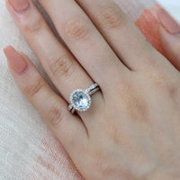 white gold oval aquamarine ring bridal set and scalloped diamond wedding band by la more design