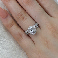 white gold oval moissanite engagement ring bridal set and milgrain diamond band by la more design