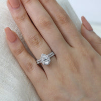 white gold pear moissanite engagement ring bridal set and pave diamond wedding band by la more design