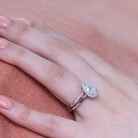 white gold halo bridal set pear moissanite ring and scalloped diamond band by la more design