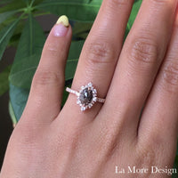 Breathtakingly stunning salt and pepper diamond engagement ring is crafted in the 14k rose gold tiara halo diamond ring setting with a 0.95-carat marquise-shaped rose cut natural grey diamond center ~ the total diamond weight of the whole ring is 1.43 ct.tw.