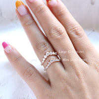 comparison of large 7 diamond wedding band vs mini diamond wedding ring by la more design jewelry