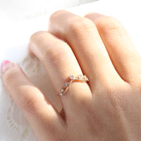 curved diamond wedding band in rose gold leaf ring by la more design jewelry