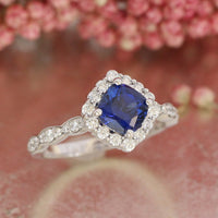 cushion blue sapphire ring scalloped halo diamond engagement ring white gold by la more design