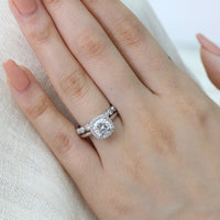 white gold cushion moissanite engagement ring bridal set and milgrain diamond wedding band by la more design