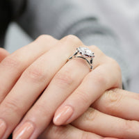 vintage inspired moissanite engagement ring in white gold diamond band by la more design