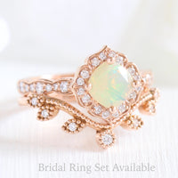 cushion cut opal ring and curved leaf diamond wedding band in rose gold bridal set by la more design