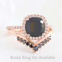 cushion halo diamond engagement ring and v shaped curved black diamond wedding band in rose gold bridal set by la more design jewelry
