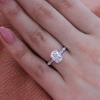 oval moissanite solitaire engagement ring in white gold scalloped diamond band by la more design