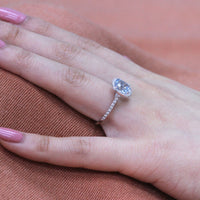 white gold halo diamond aquamarine engagement ring by la more design