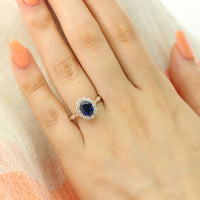 halo diamond sapphire engagement ring in yellow gold scalloped band by la more design