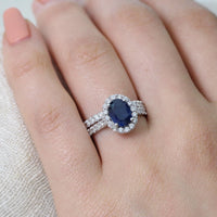 white gold halo diamond blue sapphire engagement ring bridal set by la more design