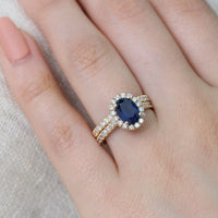 halo diamond blue sapphire engagement ring set yellow gold diamond wedding band by la more design