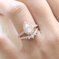 halo diamond moissanite engagement ring rose gold pear shaped ring and curved diamond wedding band by la more design jewelry