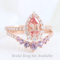 halo diamond peach sapphire engagement ring rose gold and purple sapphire wedding band by la more design jewelry