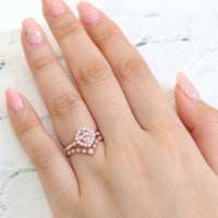 halo diamond peach sapphire ring and curved diamond band rose gold bridal set by la more design