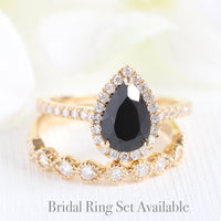 yellow gold halo diamond pear black spinel engagement ring bridal set by la more design