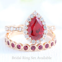 halo diamond pear ruby engagement ring rose gold bridal set bezel ruby wedding band by la more design jewelry