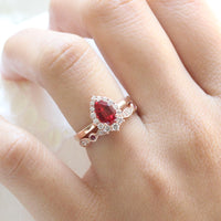 halo diamond ruby engagement ring rose gold pear shaped ring and diamond wedding band by la more design jewelry