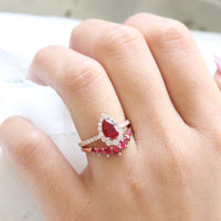 halo diamond ruby engagement ring rose gold pear shaped ring and large ruby wedding band by la more design jewelry