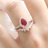 halo diamond ruby engagement ring rose gold pear shaped ring and pave diamond wedding band by la more design jewelry
