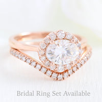 halo diamond ring bridal set and curved pave diamond wedding band in rose gold east west engagement ring by la more design jewelry