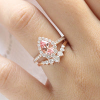 halo diamond peach sapphire engagement ring rose gold and curved diamond wedding band by la more design jewelry
