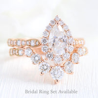halo pear moissanite engagement ring and curved diamond wedding band la more design jewelry