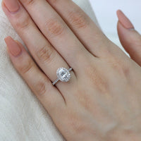 white gold oval moissanite halo diamond engagement ring by la more design