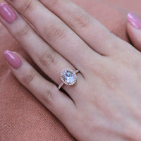 rose gold oval aquamarine halo diamond engagement ring by la more design