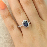 oval cut blue sapphire halo engagement ring white gold diamond scalloped band by la more design