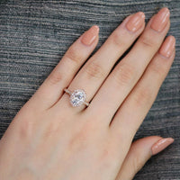 oval moissanite engagement ring in rose gold vintage inspired band by la more design