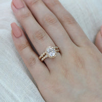 oval moissanite wedding ring set yellow gold pebble diamond band by la more design
