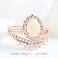 oval cut opal ring and curved crown diamond wedding band in rose gold bridal set by la more design