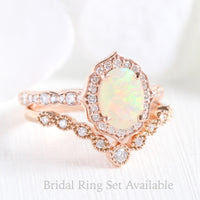 oval cut opal ring and curved diamond wedding band in rose gold bridal set by la more design