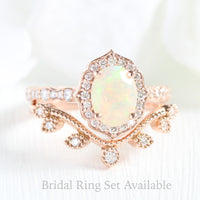 oval cut opal ring and curved leaf diamond wedding band in rose gold bridal set by la more design