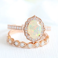 oval cut opal ring and vintage style diamond wedding band in rose gold bridal set by la more design